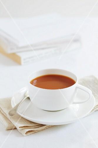 A cup of redbush tea with milk