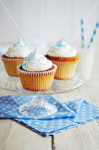 Cupcakes with white icing and blue sugar