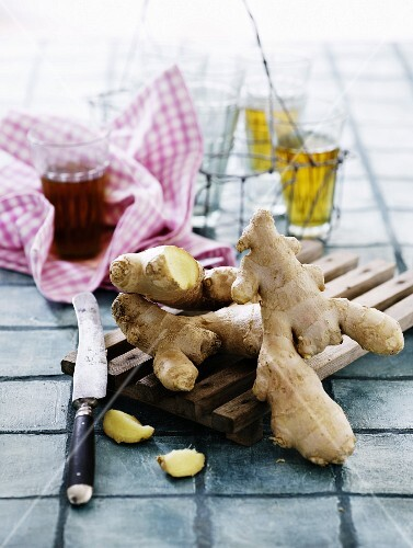 Fresh ginger roots on a wooden board