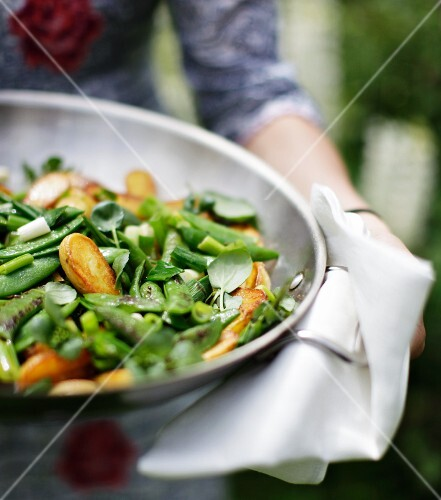 Sauteed new potatoes with green spring vegetables