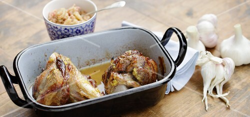 Oven-roasted lamb knuckles with young garlic served with rhubarb sauce