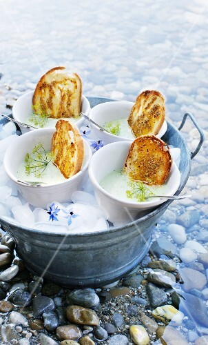 Cold cucumber soup with crispy, oven-roasted bread