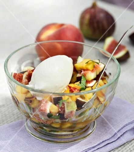 Fruit salad with homemade yoghurt ice cream