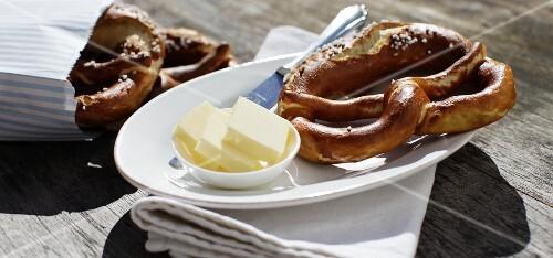 Homemade lye bread pretzels with fresh butter