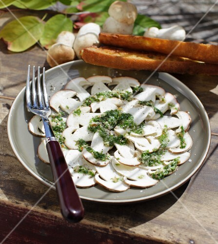 Autumnal porcini mushroom carpaccio with hazelnut pesto