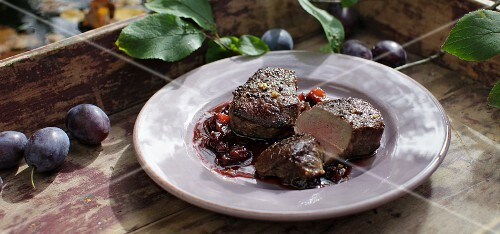 Roasted venison medallions with damsons