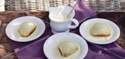 Palatinate Dampfnudeln (steamed, sweet yeast dumpling) with vanilla sauce