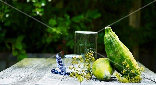 Exotic fruit on a wooden table with fennel flowers