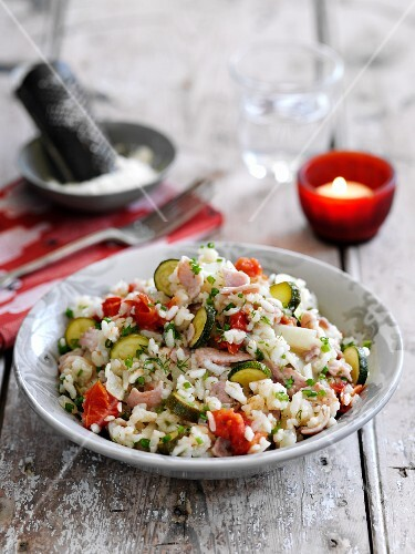 Risotto with cherry tomatoes, courgettes and bacon