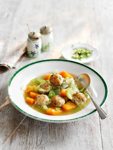 Vegetable soup with chicken and herb dumplings