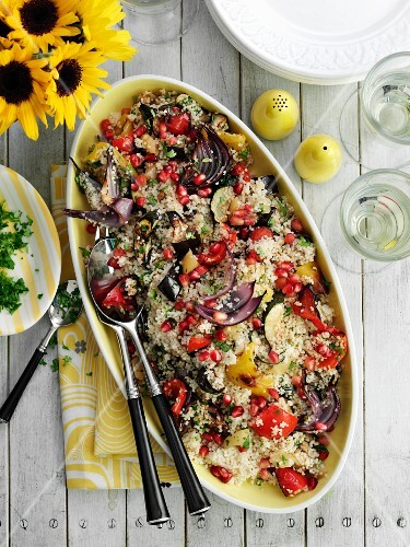 Couscous salad with vegetables and pomegranate seeds