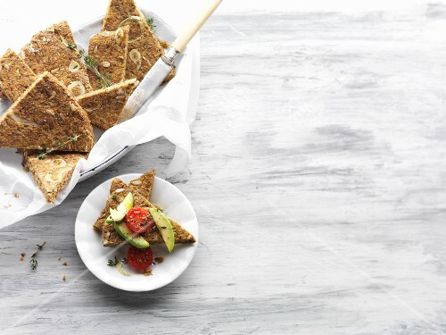 Vegan onion and courgette bread with avocado and cherry tomatoes