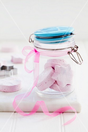 Homemade sweets in a flip-top jar with a taft bow