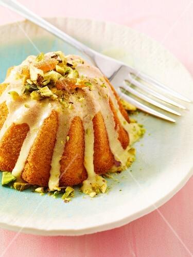 A mini Bundt cake with pistachio glaze
