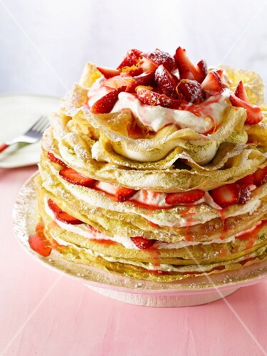 A pancake cake with strawberries and crème fraîche