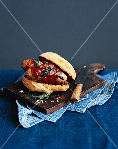 A ciabatta sandwich with sausage, sage and bacon