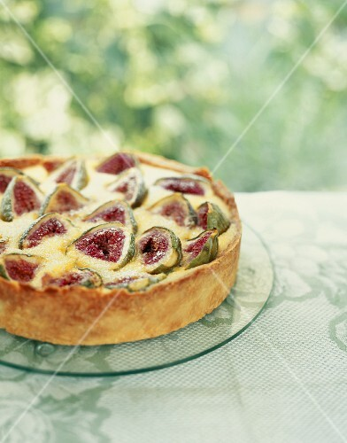 Fig and almond tart on a garden table