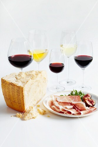 Various glasses of wine, Parma ham, figs and cheese