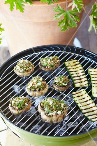Grilled courgette slices and stuffed mushrooms with herbs and cheese