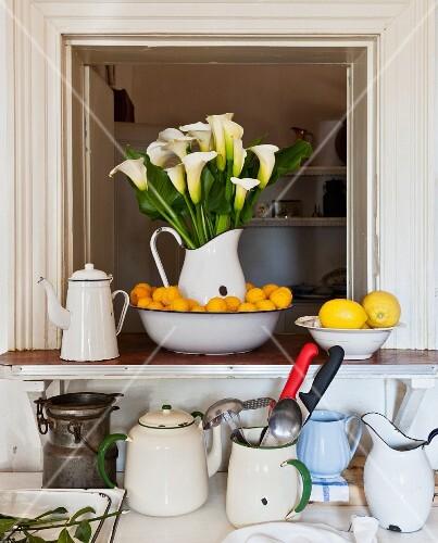 Lemons and enamel dishes