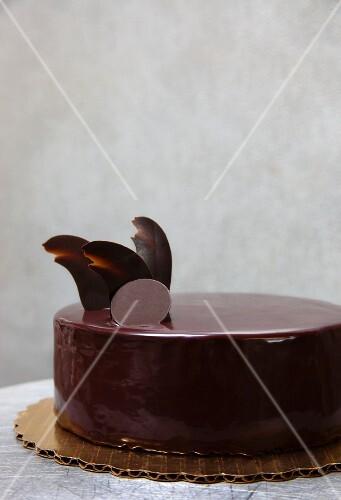 Chocolate cake with raspberry jam and chocolate glaze