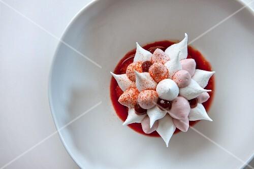 A flower-shaped meringue and berry sorbet dessert
