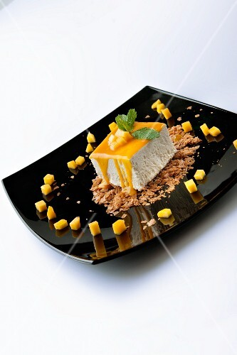 Tonka beans with mango sauce and diced mango