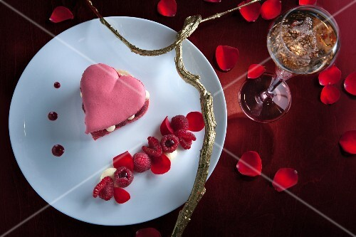 A heart-shaped macaroon with raspberries for Valentine's Day