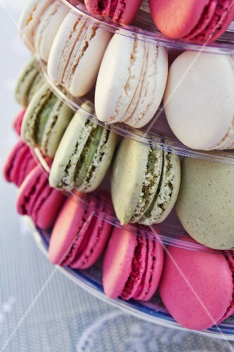 Assorted macaroons on a tiered cake stand