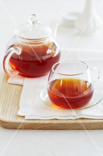 Redbush tea in a glass teapot and a cup