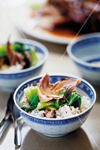 Braised knuckle of pork with bok choy and rice