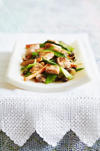 Chicken and mushroom stir fry with bok choy, carrots and black beans