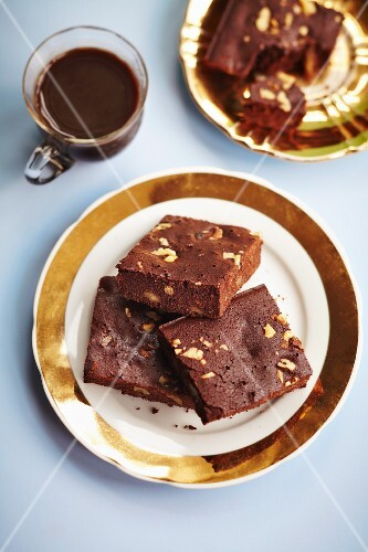 Walnut brownies with a glass of hot chocolate