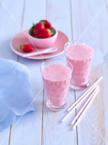Strawberry smoothies and fresh strawberries