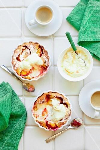 Peach soufflés with icing sugar and lemon cream