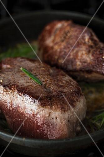 Steaks in a pan