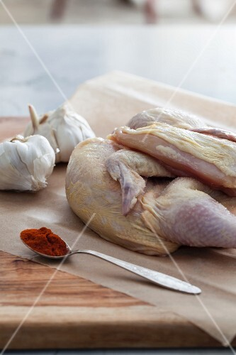 Raw chicken with paprika and garlic