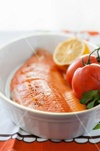 Raw Arctic char with tomatoes and lemon