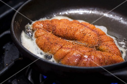 Spiced allis shad roe being fried in butter