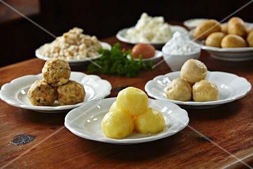 Bread dumpling, potato dumplings and quark dumplings with ingredients