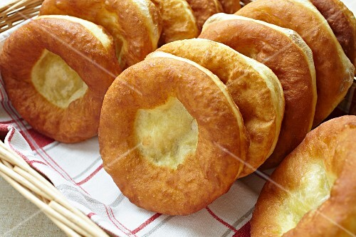 A basket of freshly baked Bauernkrapfen (Austrian yeast dough pastries)