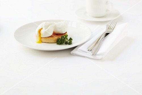 A poached egg on an English muffin