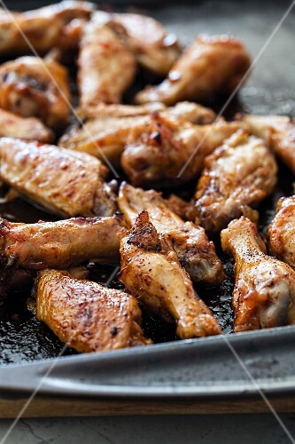 Teriyaki chicken wings on a baking tray