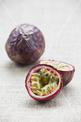Passion fruits, whole and halved
