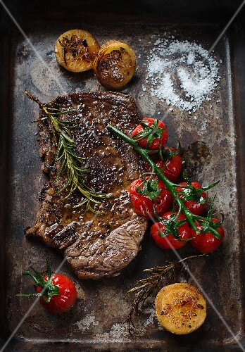 Beef steak with tomatoes and rosemary
