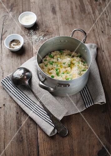 Pea risotto in a saucepan