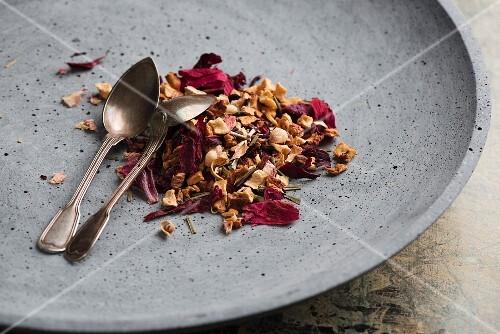 Loose leaf tea on a grey plate