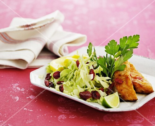 Cabbage salad with cranberries and smoked fish