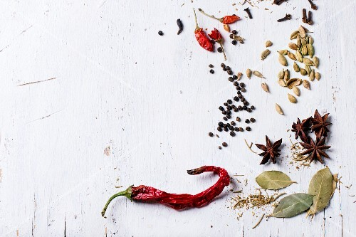 Various spices on a white surface