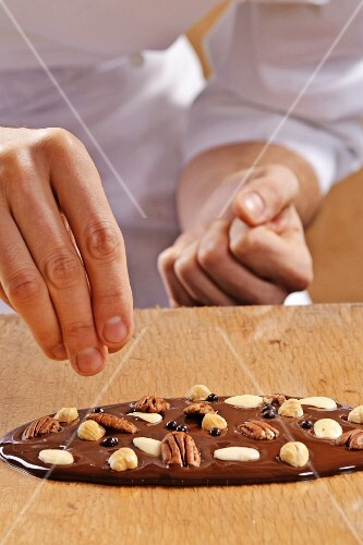 A chocolate bar with nuts being made
